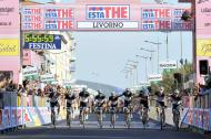 """The teammates of Wouter Weylandt and close friend and training partner Tyler Farrar, who rides for Garmin-Cervelo, third from right, cross the finish line side by side and with their arms linked at the Giro d'Italia, Tour of Italy cycling race, in Livorno, Italy, Tuesday, May 10, 2011, after completing a fourth stage honoring the Leopard-Trek cyclist who died in a high-speed crash. The Leopard-Trek team will continue to ride in the Giro d'Italia despite the death of cyclist Wouter Weylandt. The 26-year-old Belgian crashed Monday during a descent after clipping a wall during the third stage of the race and died at the scene despite medical staff trying to revive him for 40 minutes. """"We will start out of respect for the family of Weylandt and also to share our grief with the world of cycling,"""" Leopard Trek general manager Brian Nygaard said Tuesday.."""