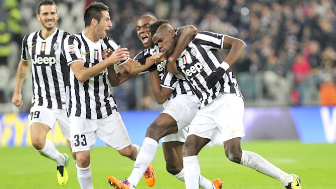 Juventus midfielder Paul Pogba, right, of France, celebrates with teammates Angelo Ogbonna and Mauricio Isla, of Chile, after scoring  during a Serie A soccer match between Juventus and Napoli at the Juventus stadium, in Turin, Italy, Sunday, Nov. 10, 2013