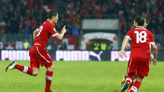Switzerland's Xhaka celebrates scoring a goal against Slovenia during 2014 World Cup qualifying soccer match in Bern
