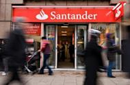 Shoppers pass a Santander branch in central London, 2010. Spain has tipped back into recession, official data showed, grim news for a cash-strapped economy hobbled by rising debt, soaring unemployment and deeply troubled banks