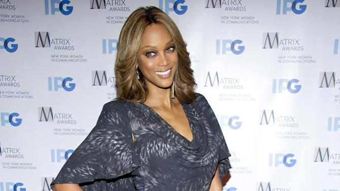 """FILE - This April 23, 2012 file photo shows Tyra Banks arrives to the Matrix Awards in New York. Banks will host a gala dubbed the """"Flawsome Ball"""" to benefit a New York City girls club.  The former model and talk show host was to announce the event Thursday. Drake will perform at the ball, which is to benefit the Tyra Banks Tzone at the Lower Eastside Girls Club. Banks formed Tzone in 1999 as a weeklong camp for girls, but the organization is now making a permanent home at the New York girls club. (AP Photo/Charles Sykes, file)"""