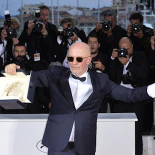 Director Jacques Audiard holds the Palme d'Or award for the film Dheepan as he poses for photographers during a photo call following the awards ceremony at the 68th international film festival, Cannes, southern France, Sunday, May 24, 2015. (AP Photo)
