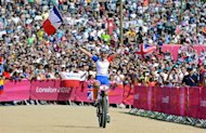 France's Julie Bresset celebrates as she wins the women's cycling cross-country mountain bike race of the London 2012 Olympic Games on August 11, 2012 at Hadleigh Farm in Benfleet. AFP PHOTO / CARL DE SOUZA