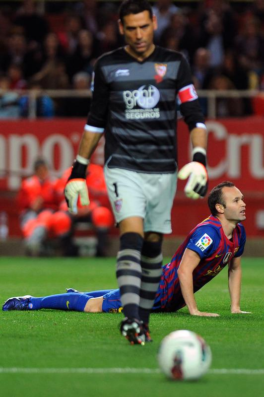 Barcelona's Midfielder Andres Iniesta (R) Gestures AFP/Getty Images