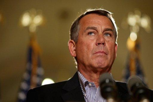 Speaker of the House John Boehner talks with reporters outside his office in the US Capitol in Washington, DC. President Barack Obama and Boehner met Sunday to discuss the so-called impending fiscal cliff of steep tax hikes and spending cuts.