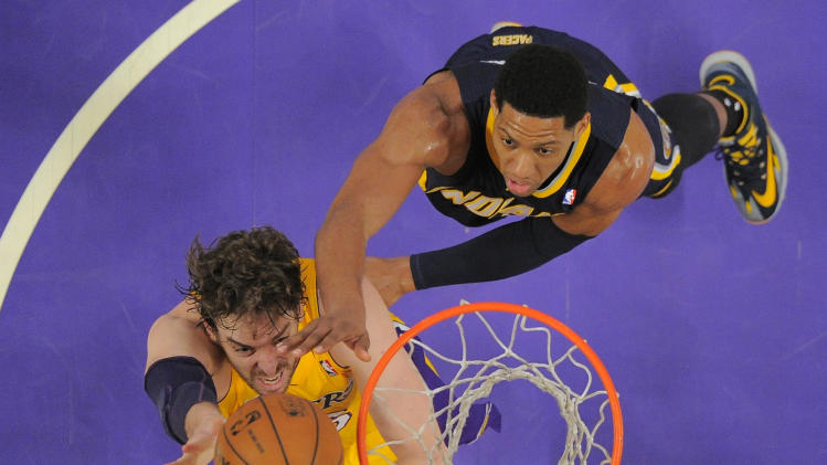 Los Angeles Lakers center Pau Gasol, left, of Spain, puts up a shot as Indiana Pacers forward Danny Granger defends during the second half of an NBA basketball game, Tuesday, Jan. 28, 2014, in  Los Angeles