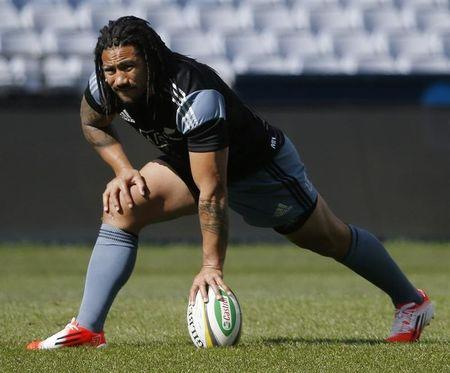 Ma'a Nonu stretches during a training session for New Zealand's All Blacks Rugby Union team in Sydney