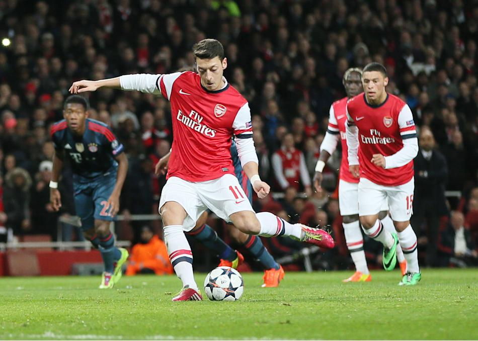 Arsenal's Mesut Ozil misses to score with a penalty during a Champions League, round of 16, first leg soccer match between Arsenal and Bayern Munich at the Emirates stadium in London, Wednesday, F