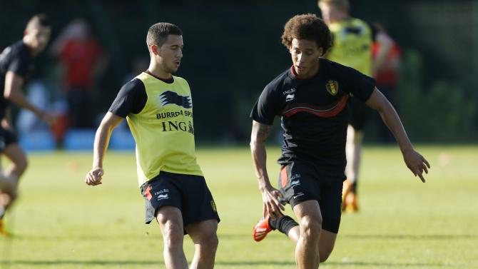 Belgian national soccer team players Hazard fights for the ball with Witsel during a training session in Brussels