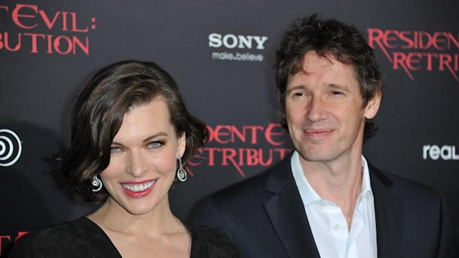"Milla Jovovich, left, and Paul W.S. Anderson attend the US premiere of ""Resident Evil: Retribution"" at Regal Cinemas L.A. Live on Wednesday, Sept. 12, 2012 in Los Angeles. (Photo by Richard Shotwell/Invision/AP)"