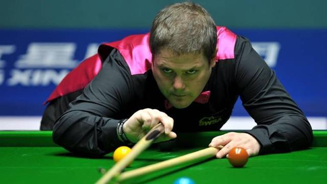 Snooker - Milkins advances in Hainan Island