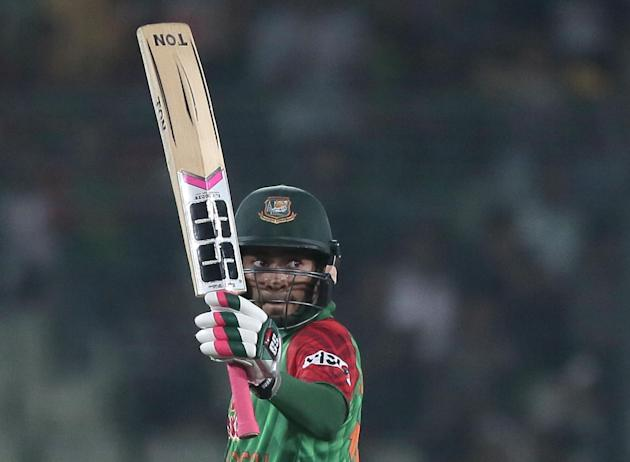 Bangladesh's Mushfiqur Rahim acknowledges the crowd after scoring fifty runs during the second one-day international cricket match against Pakistan in Dhaka, Bangladesh, Sunday, April 19, 2015. (AP Ph