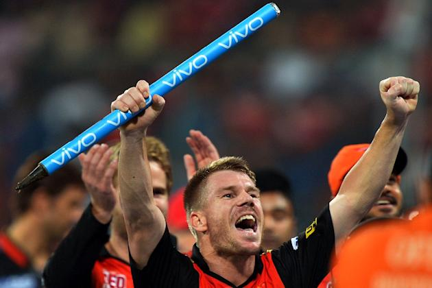 Sunrisers Hyderabad captain David Warner (C) celebrates his team's victory against Royal Challengers Bangalore during the final of the 2016 Indian Premier League on May 29, 2016