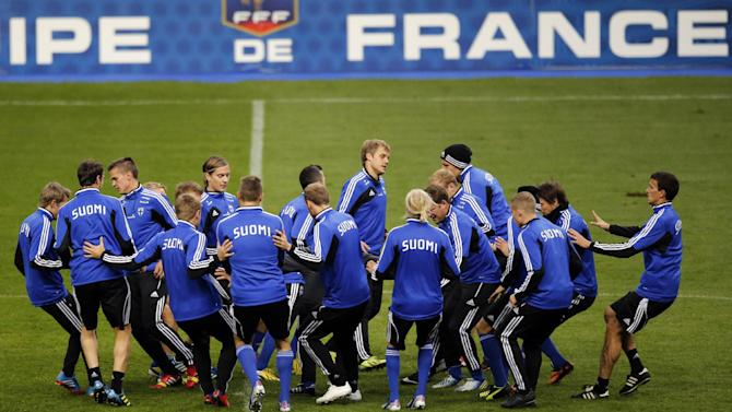 Finland's soccer team attend a training session at the Stade de France stadium in Saint Denis, north of Paris, Monday, Oct. 14, 2013, a day ahead of their 2014 World Cup Group I qualifying soccer match against France