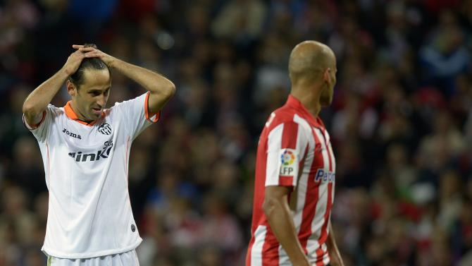 Valencia's Oliveira reacts after missing a goal, as Athletic Bilbao's Rico looks on, during their Spanish first division soccer match in Bilbao