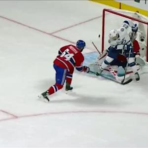 Brown deflects the puck up and over Price