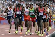 Athletes compete in the men's 5000m heats at the athletics event of the London 2012 Olympic Games. Farah remained on course for a distance double after safely negotiating his passage into the final of the 5000m