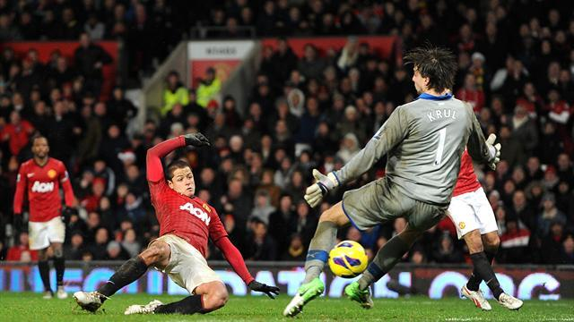 Football - United win seven-goal thriller