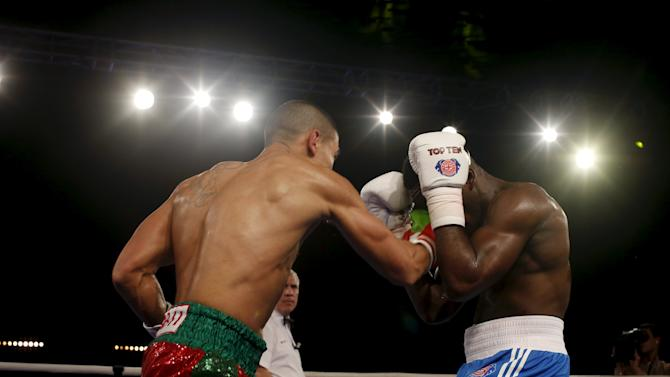 Mohammed Rabii of Morocco Atlas Lions (L) and Muhammad Ali of British Lions Hearts  exchange punches during their WSB boxing flyweight title bout in Casablanca