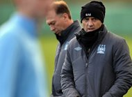Manchester City's Italian manager Roberto Mancini (R) arrives with his assistant David Platt for a training session in Manchester, north-west England, on December 3, 2012. Platt insists there should be no concerns about Manchester City's lack of goals