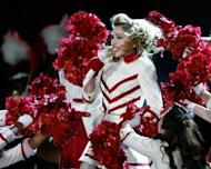 """US pop diva Madonna performs during her """"MDNA"""" world tour at Kiev's Olympic Stadium on August 4. The lead singer of the Russian punk band Pussy Riot has compared the group's trial to Stalin-era repression in a dramatic final statement before the verdict is delivered later this month"""