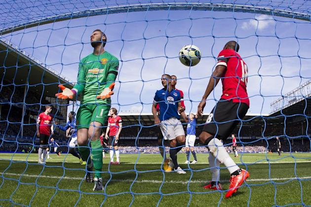 FILE - In this Sunday April 26, 2015 file photo Manchester United's goalkeeper David De Gea, foreground left, reacts in frustration after a goal by Everton's John Stones, not pictured, during