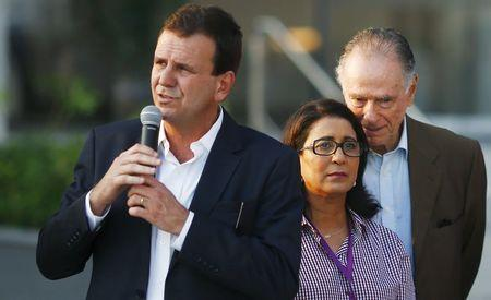 2016 Rio Olympic Games Organising Committee President Carlos Arthur Nuzman speaks to International Olympic Committee (IOC) Evaluation Commission head Nawal El Moutawakel during the inauguration ceremony of the 2016 Rio Olympics park in Rio de Janeiro