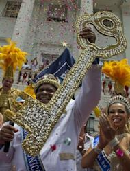 King Momo holds the key of Rio de Janeiro after receiving it from Rio's Mayor Eduardo Paes and thus officially opens the city's world famous carnival on February 8, 2013. The 150-kilogram Milton Rodrigues da Silva, the event's undisputed king for the past five years in a row, kicked off five days of nonstop partying in Brazil's Marvelous City, Rio