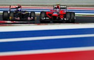 Vodafone McLaren Mercedes driver Lewis Hamilton (R) of Britain is followed by Red Bull Racing driver Sebastian Vettel (L) of Germany through turn 17 during the United States Formula One Grand Prix at the Circuit of the Americas. Hamilton won the race