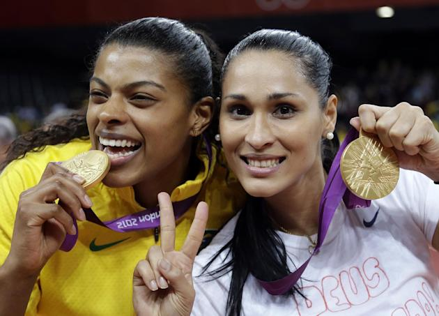 FILE - In this Aug. 11, 2012 file photo, Brazil's Fernanda Rodrigues, left, and Jaqueline Carvalho, pose with their gold medals for women's volleyball at the 2012 Summer Olympics, in London. B