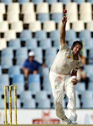 Australia's Ryan Harris makes a delivery during the second day of their cricket test match against South Africa in Centurion February 13, 2014. REUTERS/Siphiwe Sibeko