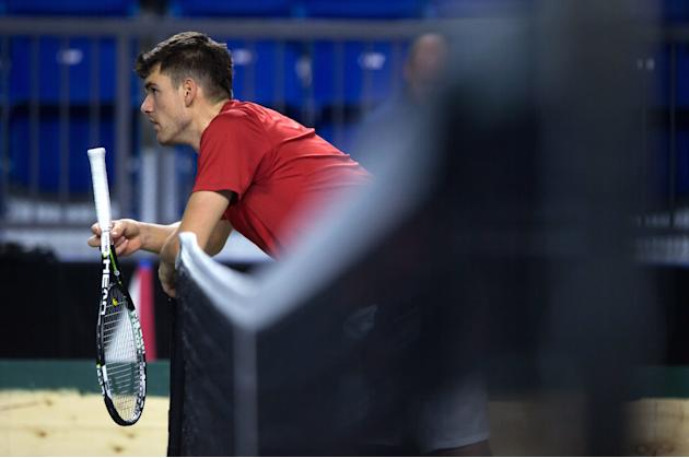 Canada's Frank Dancevic takes a break during Davis Cup tennis practice in Vancouver, British Columbia, on Monday, March 2, 2015. Canada and Japan are scheduled to meet in a Davis Cup tie starting