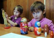 Russian children play at an orphanage in Moscow on May 12, 2012. Russian lawmakers are set to debate a bill banning all adoptions by American citizens in retaliation at US human rights legislation, despite fierce opposition by ministers who say the move will rob scores of orphans of the chance of ever having a family.