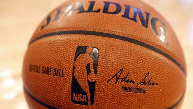 The signature of incoming NBA Commissioner Adam Silver appears on an official game ball before an NBA basketball game between the Miami Heat and the New York Knicks Saturday, Feb. 1, 2014, in New York. David Stern retired after exactly 30 years in charge, making him the NBA's longest-serving and most successful commissioner. (AP Photo/Jason DeCrow)