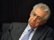 Italy's Prime Minister Monti reacts during a news conference about the labour reforms in Rome