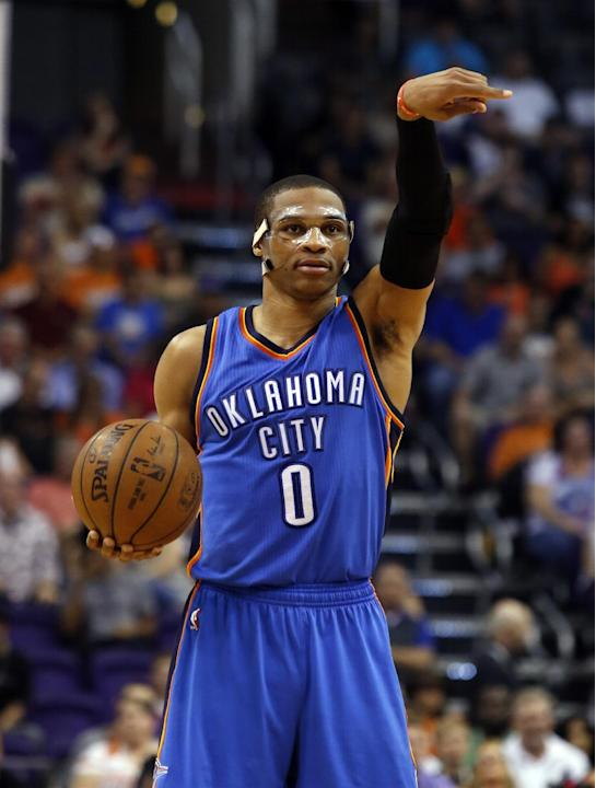 Oklahoma City Thunder guard Russell Westbrook directs traffic against the Phoenix Suns in the first quarter during an NBA basketball game, Sunday, March 29, 2015, in Phoenix. (AP Photo/Rick Scuteri)