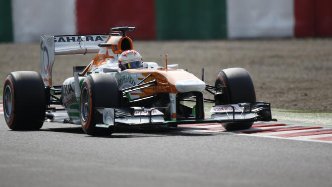 Force India Formula One driver di Resta of Britain drives during the third practice session of the Japanese F1 Grand Prix at the Suzuka circuit
