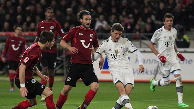 Bayern's Thomas Mueller, second right, scores during the German first division Bundesliga soccer match between Hannover 96 and Bayern Munich in Hannover, Germany, Sunday, Feb. 23, 2014