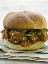 This May 2, 2011 photo shows a sesame pulled pork sandwich in Concord, N.H. Sprinkle the serving of pulled pork with sesame seeds and scallions before serving. (AP Photo/Matthew Mead)