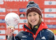 Britain's Lizzy Yarnold celebrates after winning the skeleton World Cup final in Schoenau, southern Germany, on January 24, 2014