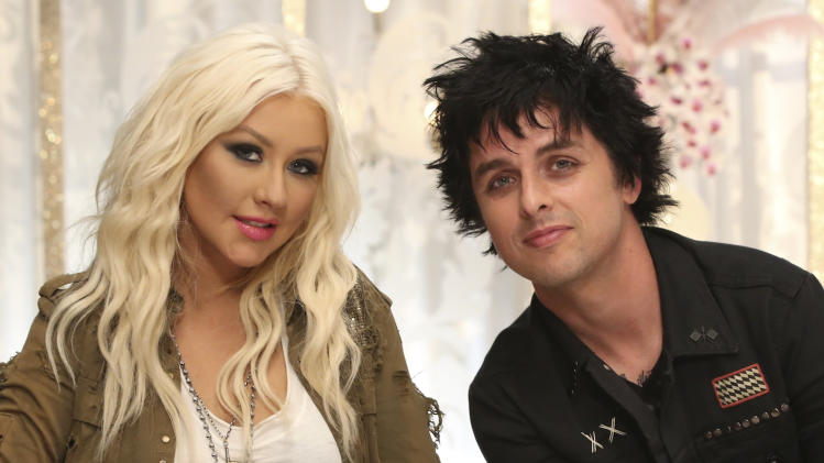 "In this Wednesday, July 25, 2012 publicity photo provided by NBCUniversal, Billie Joe Armstrong, right, sits with  Christina Aguilera.  Armstrong will join Aguilera as her team's mentor this season on NBC's , ""The Voice.""  (AP Photo/NBCUniversal, Tyler Golden)"