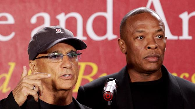 "Jimmy Iovine, the co-founder of Interscope Records, left, stands with partner hip-hop mogul Dr. Dre, as they announce a $70 million dollar donation to create the new ""Jimmy Iovine and Andre Young Academy for Arts and Technology and Business Innovation,"" Wednesday, May 15, 2013, at the University of Southern California, during a news conference at in Santa Monica, Calif.  (AP Photo/Damian Dovarganes)"