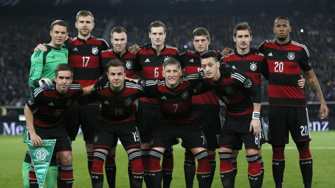 Germany's national team players line-up before their international friendly soccer match against Chile in Stuttgart
