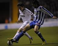 Real Madrid's midfielder Kaka (L) clashes with Deportivo's midfielder Abel Aguilar during the Spanish league football match at Riazor stadium in Coruna on February 23, 2013. Real Madrid had to come from behind as second-half goals from Kaka and Gonzalo Higuain handed them a hard-fought 2-1 at relegation threatened Deportivo La Coruna