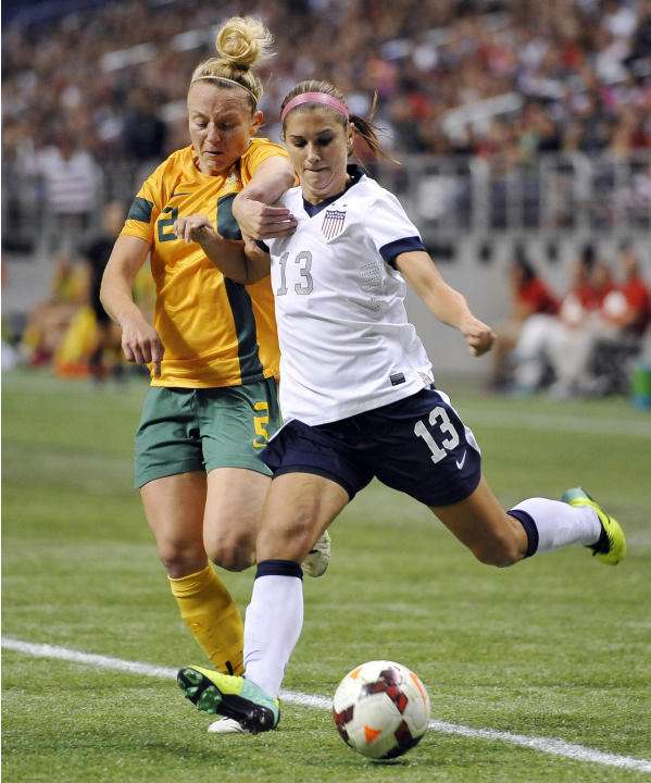 FILE - In this Oct. 20, 2013 file photo, USA forward Alex Morgan, right, tangles with Australia defender Teigen Allen during the first half of an international friendly women's soccer match in San