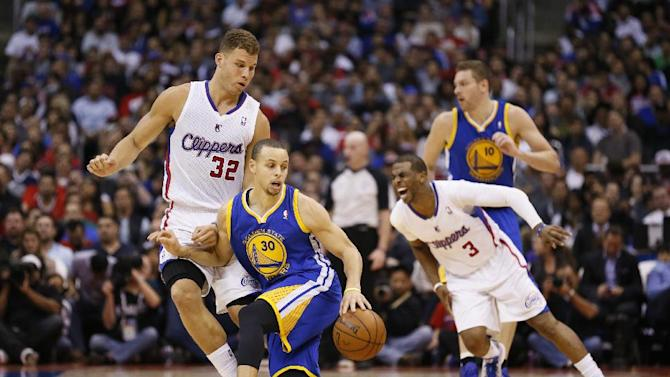 Golden State Warriors' Stephen Curry controls the ball while Los Angeles Clippers' Blake Griffin, left, defends and Warriors' David Lee, rear right, and Clippers' Chris Paul, fright front, fight for position during the first half of an NBA basketball game in Los Angeles, Wednesday, March 12, 2014