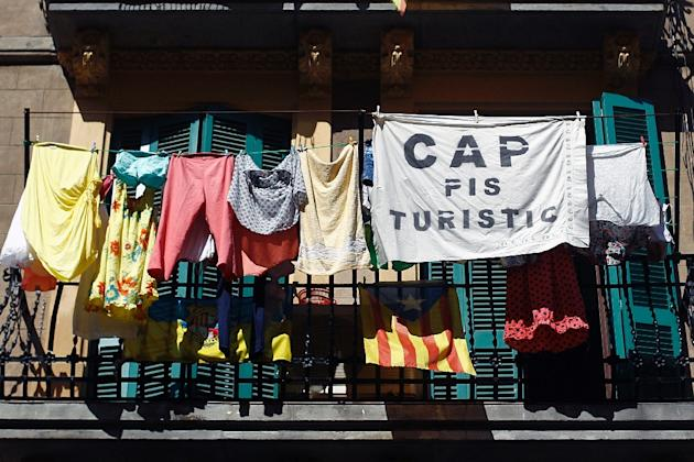 A banner reading in Catalan 'No tourist flats' is seen on a balcony in La Barceloneta suburb of Barcelona
