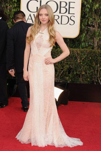 Amanda Seyfried: She may not be nominated for her role in 'Les Miserables,' but Seyfried is a winner on the red carpet in a delicate Givenchy lace gown. (Photo by Steve Granitz/WireImage)