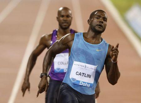Gatlin from the US competes in the men's 100 meters event during the Diamond League meeting in Doha