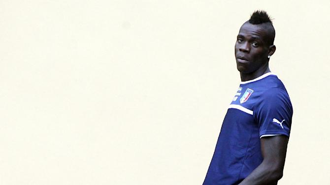 Italy's Mario Balotelli waits for the start of a training session at the Coverciano training grounds, near Florence, Italy, Monday, Oct. 7, 2013. Italy is scheduled to play a World Cup qualifier soccer match against Denmark, in Copenhagen, Friday, Oct. 11